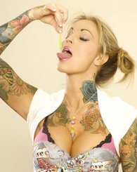 Janine Lindemulder shows off her more fun, playful side but as always keeps it very sexy and very yummy.